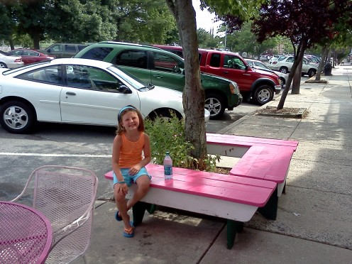 Table outside of ice cream shop.