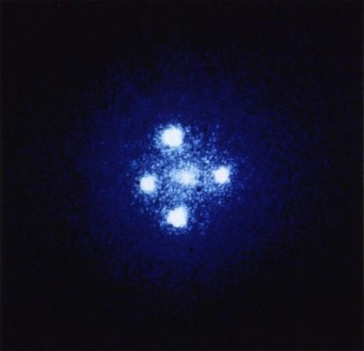 Gravitational lens G2237 + 0305, also known as the Einstein Cross. General relativity at work.