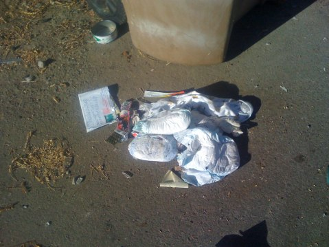 Used diapers on the ground.