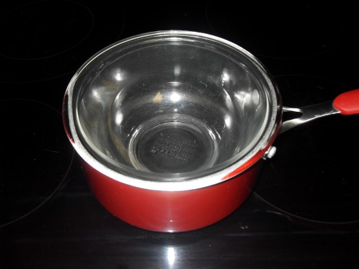 Large saucepan with smaller bowl inside of it
