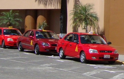 "The registered, licensed cabs in Costa Rica are red.  Pirate taxis come in many colors.  Be safe and use a licensed cab.  You don't necessarily get a better deal with ""piratas,"" as they are called."