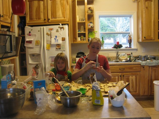 Betty and her sister Leona painting sugar cookies this Christmas.