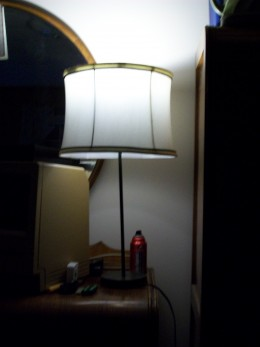 A lamp with a 7.5 watt LED made by Utilitech installed.