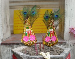 Feathered Buddhist artistic offering: an example of Thai's regard for beauty. Buddhism inspires multiple creative expressions all through Thailand.  Bangkok, Thailand.