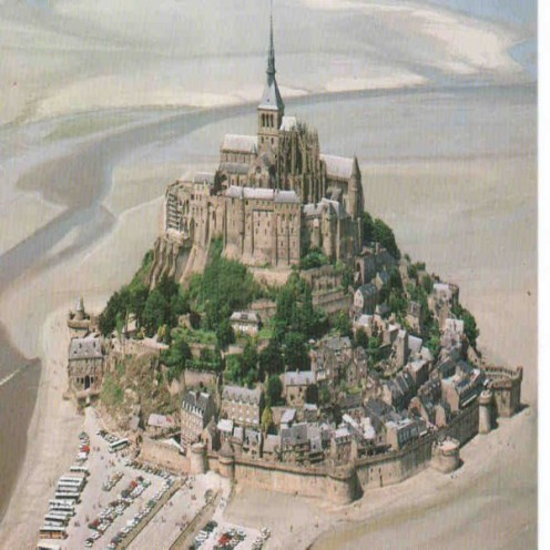 Le Mont-St-Michel  is situated in Normandy, France at the mouth of Couesnon River in Normandy
