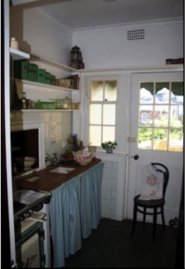 The kitchen is adjacent the dining room  and a connection is made via the servery  hatch.  The kitchen is an extremely small  room (reputedly at May Gibbs' own  request) housing little more than a sink,  stove and some shelves that have been  reconst
