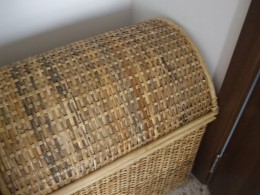 Wicker basket fitting perfectly between the wardrobe and the door.