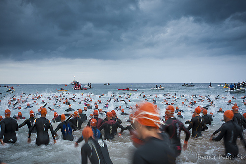 Ready to start an Ironman competition- wetsuits help maintain body temperature in cold water environments