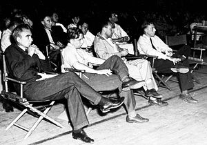 Physicists at a Manhattan District-sponsored colloquium at Los Alamos in 1946. In the front row are (left to right) Norris Bradbury, John Manley, Enrico Fermi and J. M. B. Kellogg. Robert Oppenheimer is in the second row on the left; to the right in