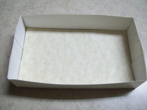 Cover bottom of box with card stock.