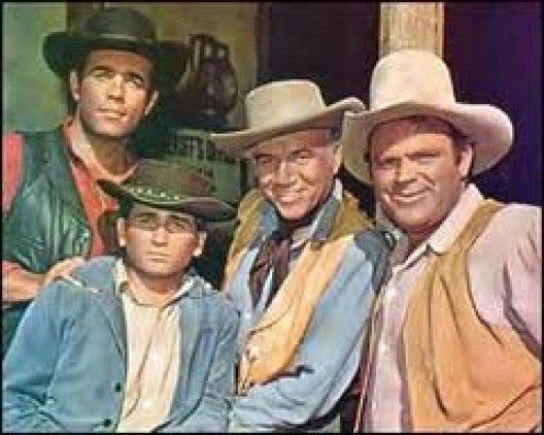 (FROM LEFT) ADAM, JOE, BEN, AND HOSS POSE FOR A FRIENDLY PHOTO WHILE TAKING A BREAK FROM RANCHING AND ENJOYING A VISIT TO A NEARBY TOWN.