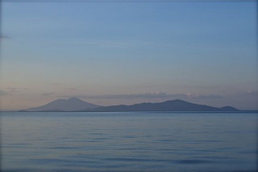 Ometepe Island, as seen from the shore of Lake Nicaragua at San Jorge one evening.
