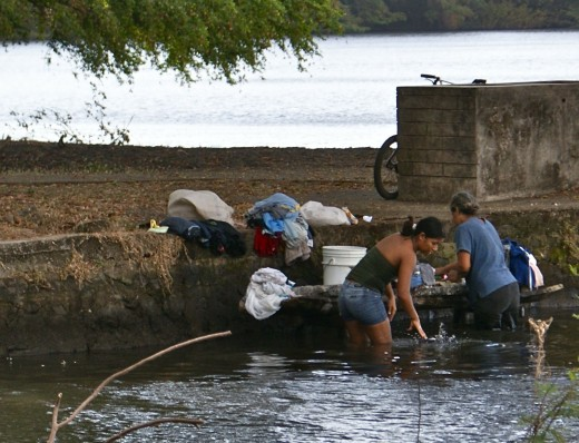 Women washing clothes along the shores of Lake Nicaragua near Charco Verde.