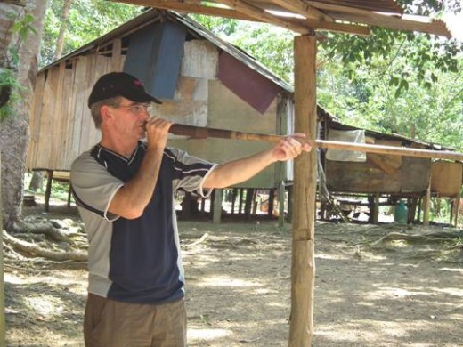 Taking aim with an Orang Asli Blowpipe