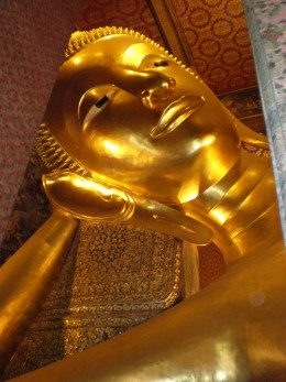 Head of the largest Reclining Buddha Sculpture in Thailand. Wat Pho Temple, Bangkok.