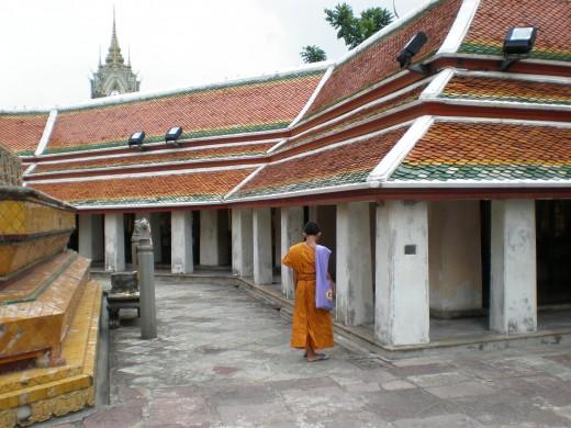 Buddhist monk. Wat Pho Buddhist Complex in Bangkok, Thailand.