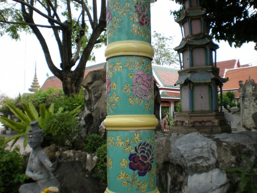 Detail of an unusual lamp-post. Wat Pho Buddhist Complex in Bangkok, Thailand.