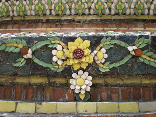 Decorative detail of a mosaic stupa. Wat Pho Buddhist Complex in Bangkok, Thailand.