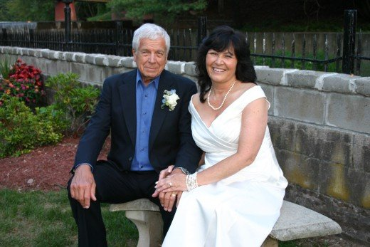 Here we are on our wedding day, with my dress bought with a coupon, my husband in his own suit!