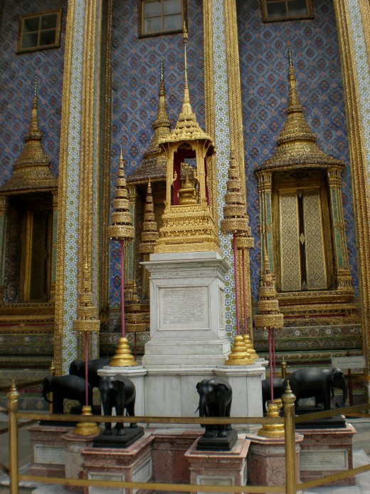 Buddhist art often includes elephant images and sculptures like these ones. Buddhist Temple of Wat Phra Kaew in Bangkok, Thailand.
