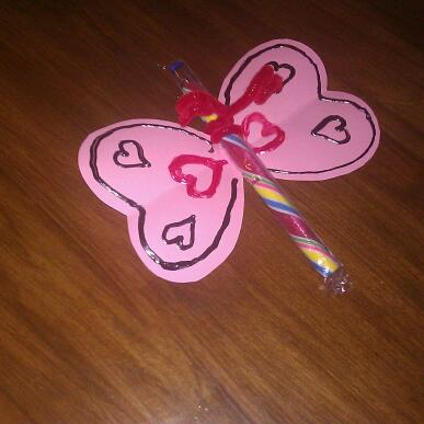 """""""You make my heart flutter by."""" Homemade Valentine with an old-fashioned candy stick"""