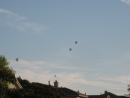 Hot air balloons over our home.