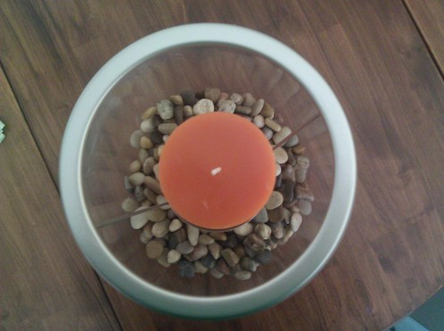 Refresh the look of your home frequently and affordably with changeable pieces like this Clearly Creative hurricane lamp from PartyLite, shown here with decorative rocks I purchased from the dollar store.