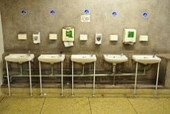 SKIMPY URINALS FOR GUYS IN THEIR REST ROOMS. NO WONDER GUYS ARE DEPRESSED WHEN THEY 'DO THEIR BUSINESS' AND GET BACK IN THE CAR.
