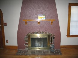 Imagine tiling an arch design like the brickwork around this fireplace. Use your imagination to make your own, creative arched design.