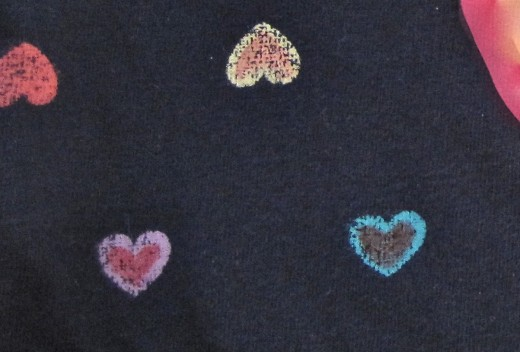 FabricMate Dye markers were used to highlight some of the preprinted hearts on this little playtime tee shirt.