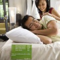 """""""This one will do,"""" says this happy guy with the pretty girl, who happens to be his girlfriend. She is happy because him loving a mattress is a sign that he has marriage on his mind."""