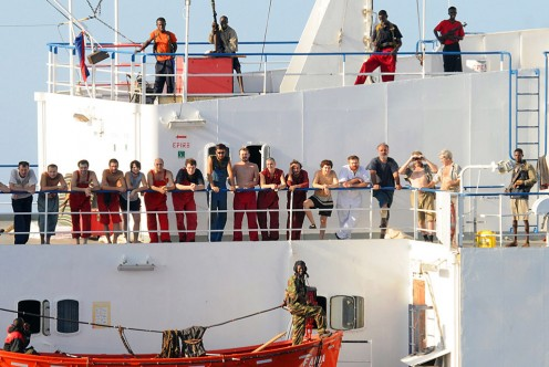 The crew of the hijacked Ukrainian merchant vessel MV Faina stand on the deck, under the watch of armed Somali pirates on November 9 after a US Navy request to check on their health and welfare, at sea off the coast of Somalia. (HO/AFP/Getty Images)