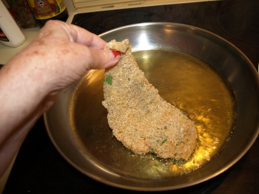 Put a generous amount of Olive Oil into a large fry pan place the cutlets into the hot (Not too hot) oil.