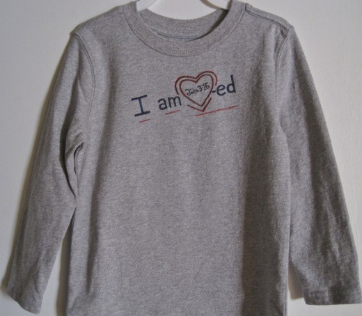 Long sleeved gray t-shirt painted for Valentine's Day is just right for playing or napping.