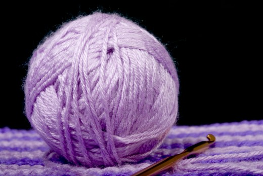BALL OF YARN by Dennist1 DESCRIPTIONBall of yarn sitting on crochet work with hook