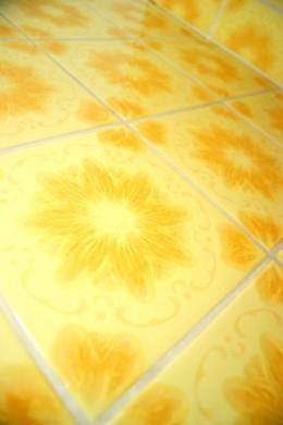 Remove vinyl floor tiles before laying a new floor.