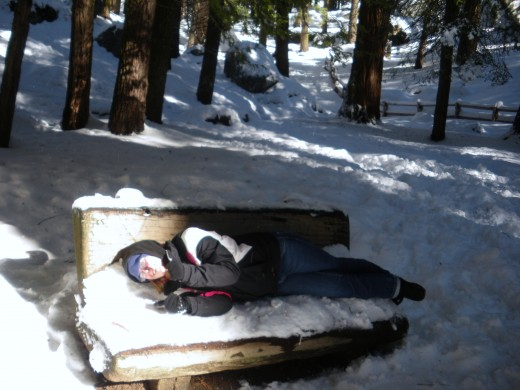 Acting a fool again; lying on a bench covered in snow in California!