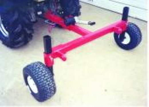 3-Point Wheeled Implement Carrier acts as a fith wheel.  Use on garden tractors and ATVs