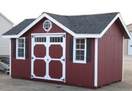 """This red Victorian Cottage has a 10x16 ft standard layout, with black """"Garden Shed"""" optional trim."""
