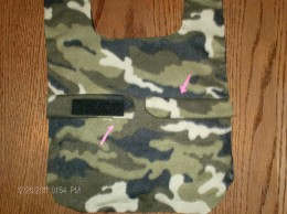 Place belly bands facing each on the outside of coat.