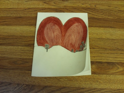 In this phase of the drawing I have finished coloring in the red heart.