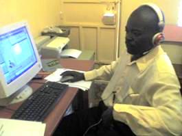 Samweya at his writing desk