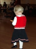 Little girl running away with a krumkake, SON Christmas party 2007, Portland, OR, USA