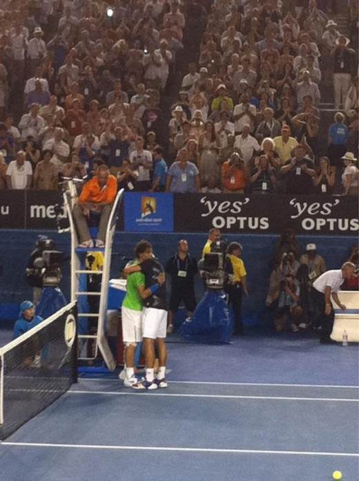 Nadal & Djokovic embrace after five hours and fifty two minutes of fierce Tennis