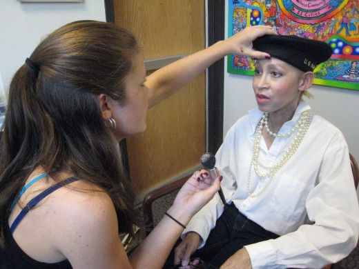 Victoria Moore having her make-up professionally done before a videotaped interview about having breast cancer.