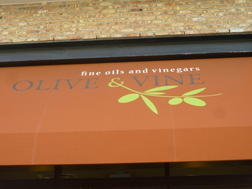 Colorful awning over the windows and door welcoming one into the Olive & Vine.