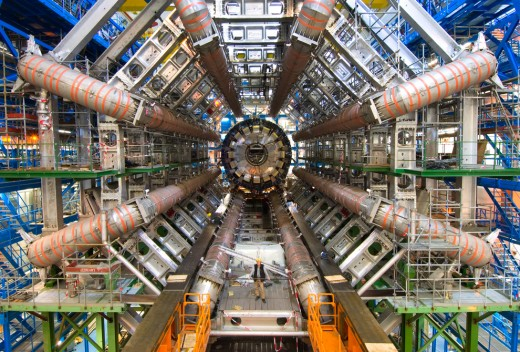 The Large Hadron Collider is the largest piece of machinery ever built. It measures 27 km, (17 mi.). By looking at the man near bottom center, we can get a scale of just a small part of the machine. We can build to this size or larger in space.