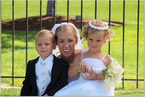 Both the ring bearer and flower girl are cousins of the bride