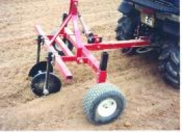 Three Point Hitch with a row builder attached to a fifth wheeled adapter for use on garden tractor or ATV.