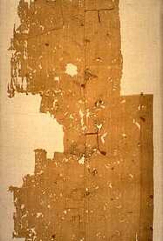 Tattered remains of Harald's Land-Oda banner heralded as 'the fairy flag' under glass at Dunvegan Castle on Skye